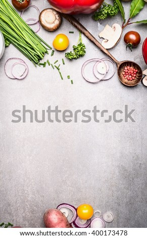 Healthy cooking with fresh vegetables and seasoning ingredients on rustic stone background, top view, place for text., frame. Healthy lifestyle and diet food concept. - stock photo