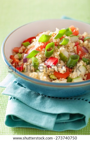 healthy couscous salad with tomato cucumber onion chives - stock photo
