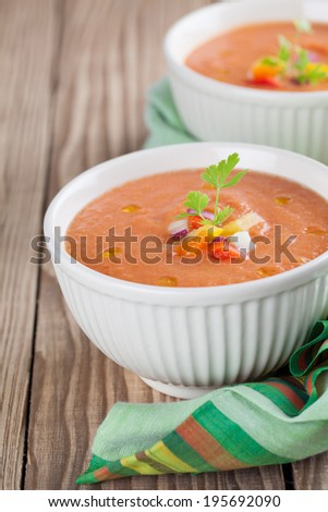 Healthy, delicious and refreshing Spanish cold soup gazpacho in bowls - stock photo