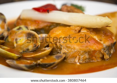 Healthy delicious hake fish dish - stock photo