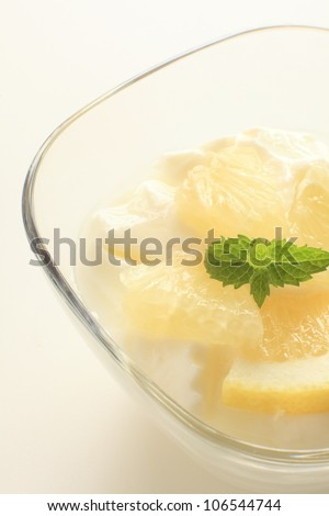 Healthy dessert, grapefruit and yogurt with mint