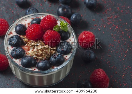 Healthy dessert. Homemade natural yogurt with fresh berries and muesli.  Selective focus - stock photo