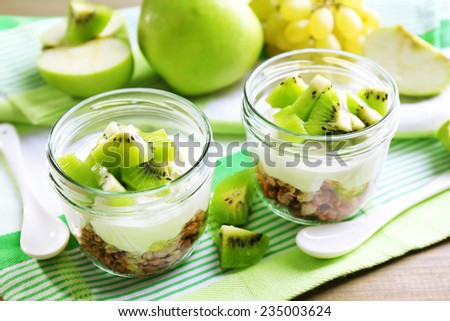 Healthy dessert with muesli and fruits on table - stock photo