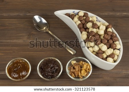 Healthy Diet breakfast of oatmeal, cereal and fruit. Foods full of energy for athletes. The concept of diet food. Preparing homemade breakfast. Vegetarian diet. Food on a wooden table.