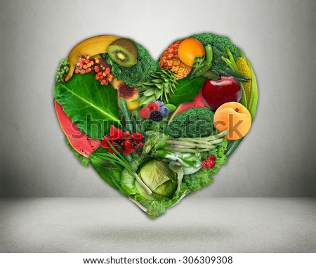Healthy diet choice and heart health concept. Green vegetables and fruits shaped as heart  Heart disease prevention and food. Medical health care and nutrition dieting  - stock photo