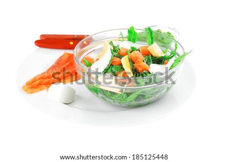 healthy diet food - fresh green lettuce salad with smoked salmon an light white goat feta cheese in transparent bowl isolated over white background - stock photo