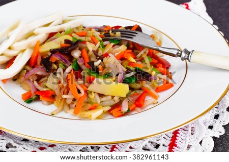 Healthy, diet: Mushrooms mun, bamboo shoots, soy sprouts, peppers, leeks with squid. Studio Photo