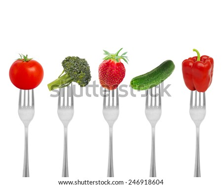 Healthy diet, organic food on forks with vegetables and berries. Diet concept nutrition. - stock photo