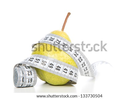 Healthy diet weight loss concept with pear and tape measure on a white background - stock photo