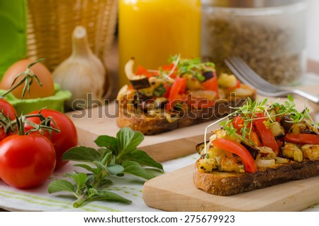 Healthy dinner - a panini toast with Mediterranean vegetables and herbs