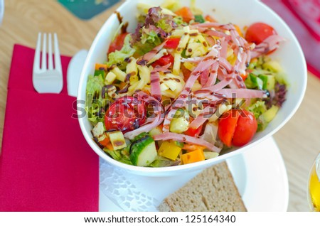 Healthy dish of salad with ham and cheese - stock photo