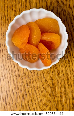 Healthy dried apricot fruit in a snack bowl.