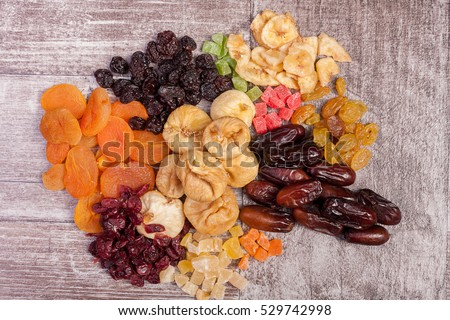 Healthy dried food nutrition on white wooden background