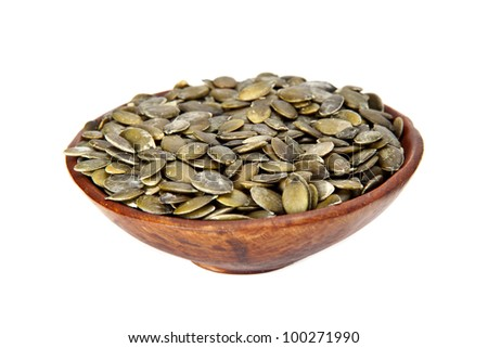 Healthy dried pumpkin seeds on a white background. Dried pumpkin seeds. - stock photo