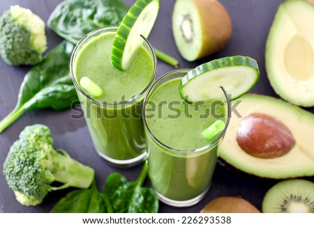 Healthy drink with ingredients on wooden background - stock photo