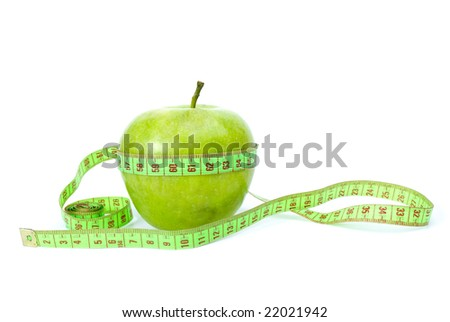 Healthy eating and diet concept: Green apple and measurement tape isolated on the white background
