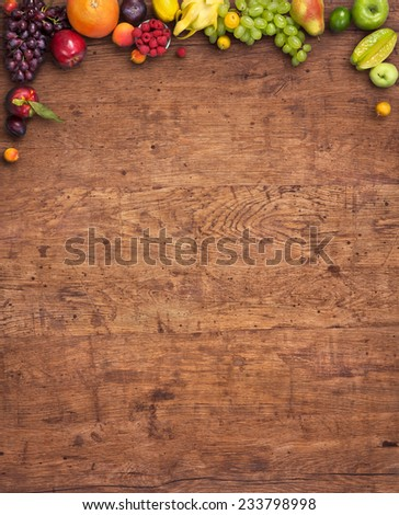 Healthy eating background / studio photography of different fruits and vegetables on old wooden table  - stock photo