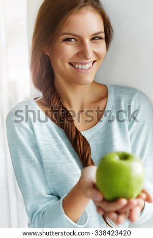 Healthy Eating. Beautiful Happy Young Woman With Fresh Green Apple. Fruits. Diet. Dieting Concept. Healthy Lifestyle Concept. Healthy Food.  - stock photo