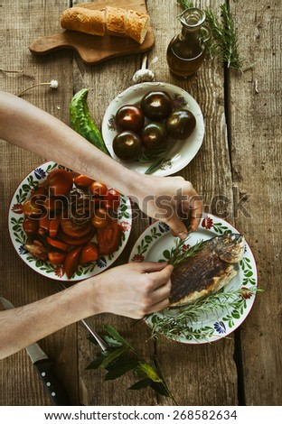 Healthy eating. Bream fish preparation. Seafood with vegetables