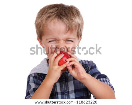 Healthy eating childhood nutrition concept small boy eating a red apple - stock photo