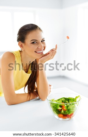 Healthy Eating. Close Up Portrait Of Young Smiling Vegetarian Woman Eating Fresh Healthy Vegetable Salad In Modern Kitchen. Healthy Food, Lifestyle Concept. Health, Dieting, Diet. Nutrition. - stock photo