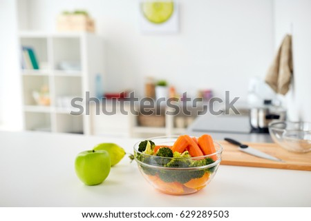 Healthy Eating, Cooking And Food Concept   Vegetables And Fruits On Kitchen  Table At Home