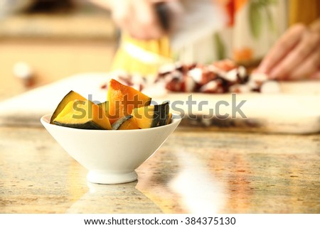 healthy eating, cooking, vegetarian food, dieting and people concept - close up of woman chopping ingredient with knife on cutting board - stock photo