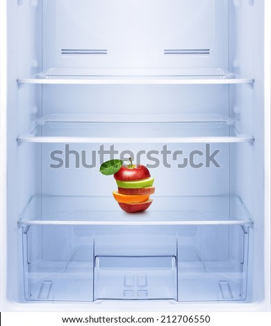Healthy eating, diet concept. Apples and orange fruit in empty refrigerator.  - stock photo