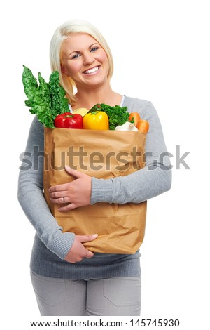 healthy eating diet woman with fresh vegetables in shopping bag