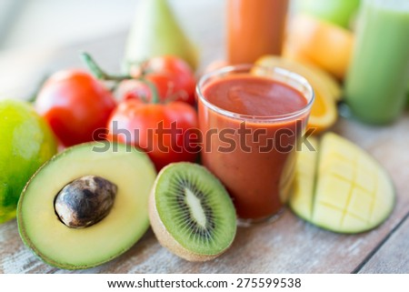 healthy eating, food and diet concept- close up of fresh juice glass and fruits on table - stock photo