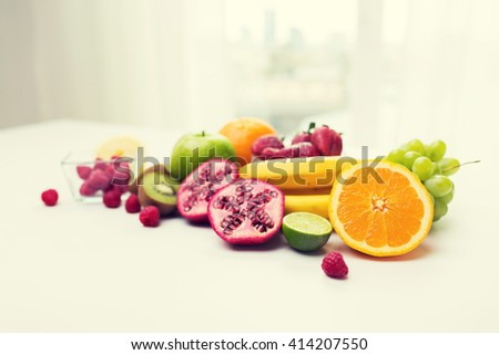 healthy eating, food and diet concept- close up of fresh ripe fruits and berries on table - stock photo