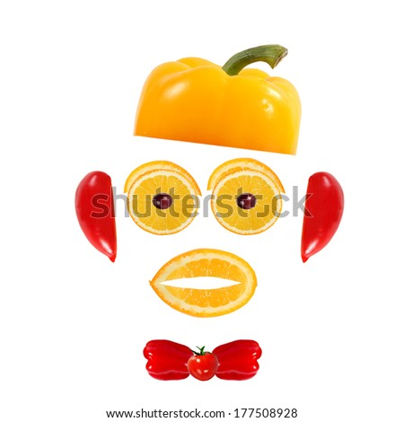 Healthy eating. Funny face made of vegetables and fruits - stock photo