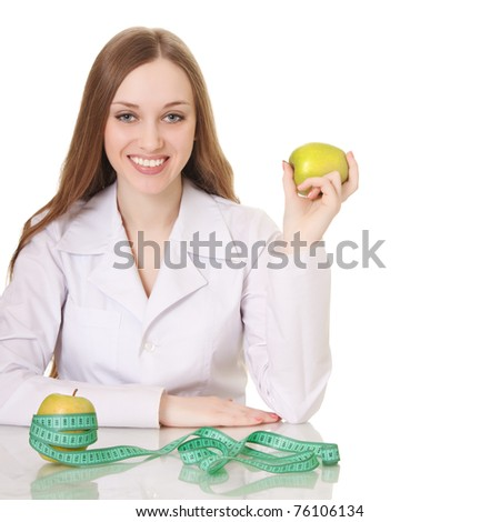 Healthy eating or lifestyle concept. woman doctor with a green apple. - stock photo