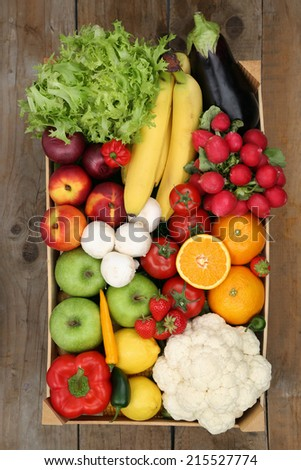 Healthy eating shopping at market fruits and vegetables in box from above - stock photo