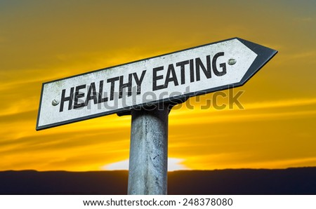 Healthy Eating sign with a sunset background - stock photo