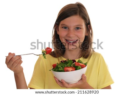 Healthy eating smiling girl with fresh salad, isolated on a white background - stock photo