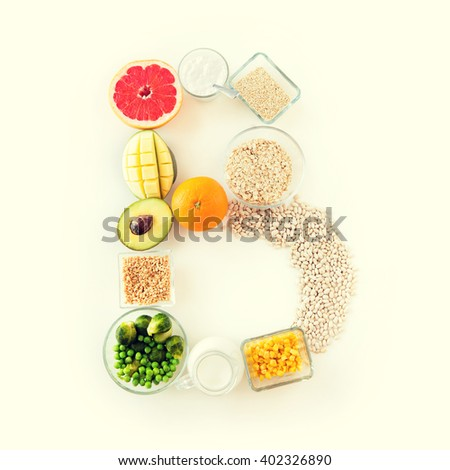 healthy eating, vegetarian food, diet and culinary concept - close up of food ingredients in letter b shape - stock photo