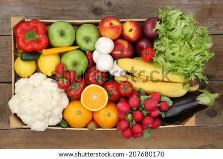 Healthy eating vegetarian fruits and vegetables in a box from above - stock photo