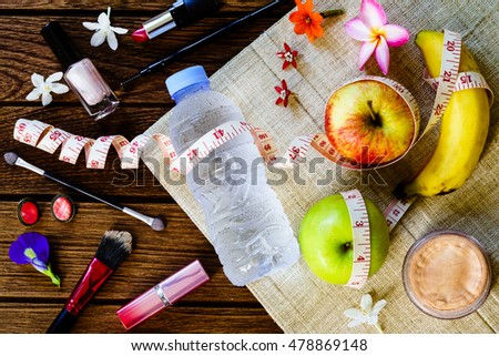 Healthy eating with women's cosmetic accessories concept