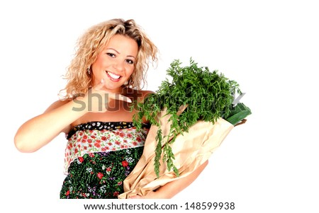 Healthy eating  woman  showing on green vegetables in shopping bag