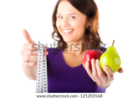 Healthy eating, woman with apple and pear and measuring tape - stock photo