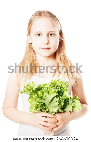 Healthy Eating. Young Girl holding green Lettuce - stock photo