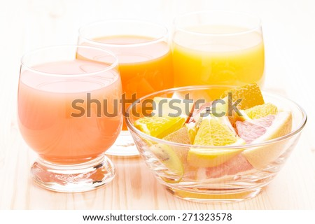 Healthy eco food. Vegetarian fruit breakfast background. Fresh orange with glass of juices - stock photo