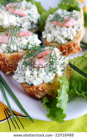 Healthy enrich sandwiches with shrimps, boiled eggs, green vegetables and herbs, blur background, vertical - stock photo