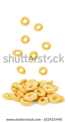 healthy falling cereal rings isolated on white background - stock photo