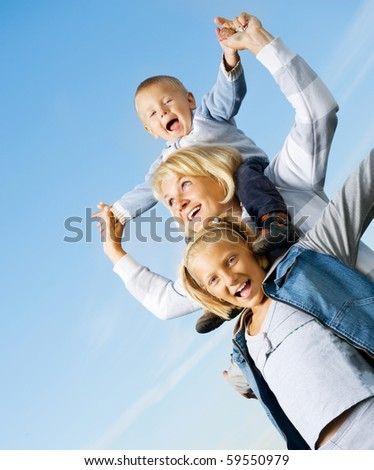 Healthy Family Outdoor.Happy Mother with Kids over blue sky - stock photo