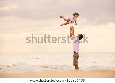 Healthy Father and Daughter Playing Together at the Beach at Sunset. Happy Fun Smiling Lifestyle - stock photo