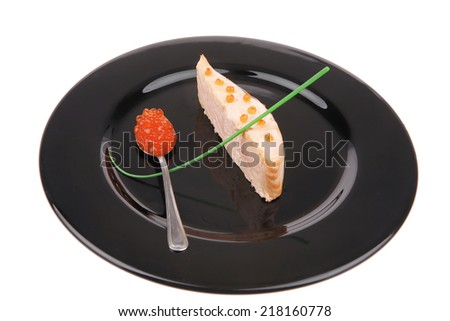 healthy fish cuisine : roasted pink salmon fillet with  onion pen , and red caviar in spoon on black dish isolated over white background