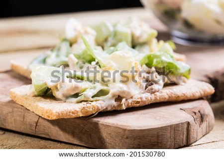 Healthy fish egg veg salad with garlic souse put on the crispbread   - stock photo