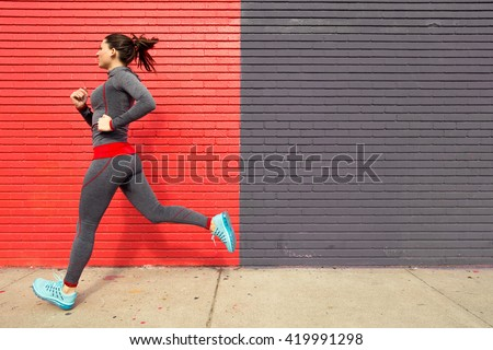 Healthy fit woman exercising with a run jog in the city sidewalk confident and powerful - stock photo
